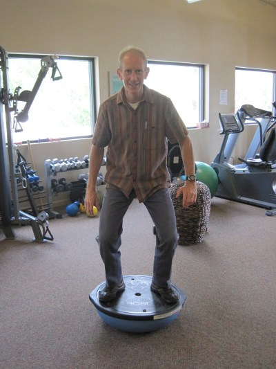 standing on a bosu ball to get in shape for snowboarding
