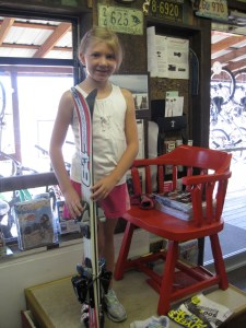 Katie with her skis for this season. She is a light-weight, less-aggressive skier, so shorter is better for her.