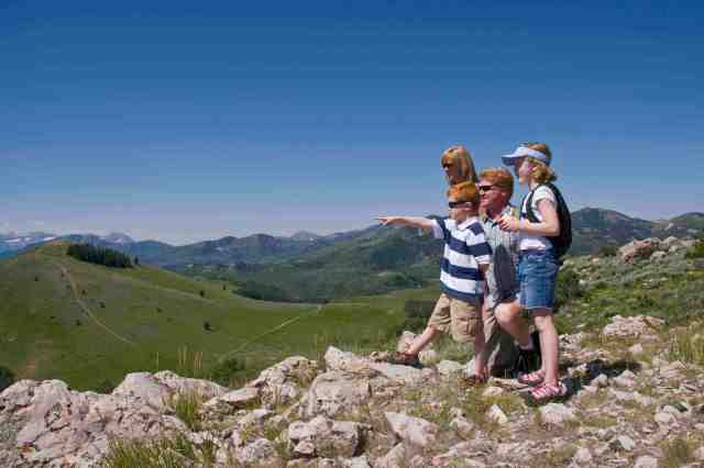 a family with young children hiking at deer valley resort utah