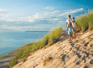 a family walking along lake michigan at sleeping bear dunes