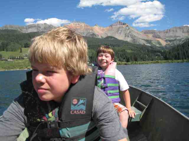 two brothers rowing a boat in the san juan mountains of colorado