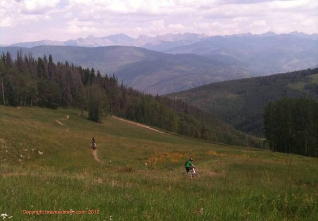 mountain biking through a meadow at Beaver Creek colorado