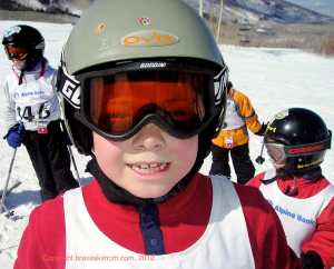 junior racers in ski helmets colorado