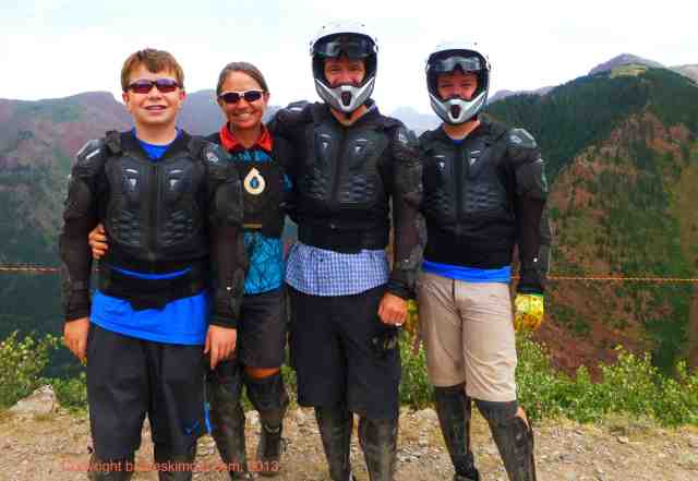a family dressed in body armor for downhill biking at Bike Snowmass near aspen colorado