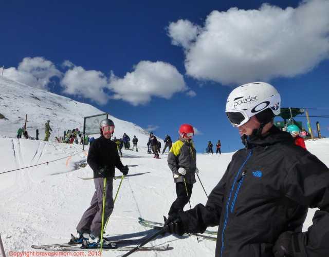 family skiing a basin