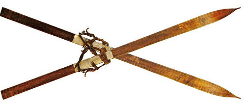 Antique wooden skis crossed