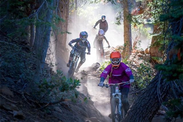 women dh biking north star