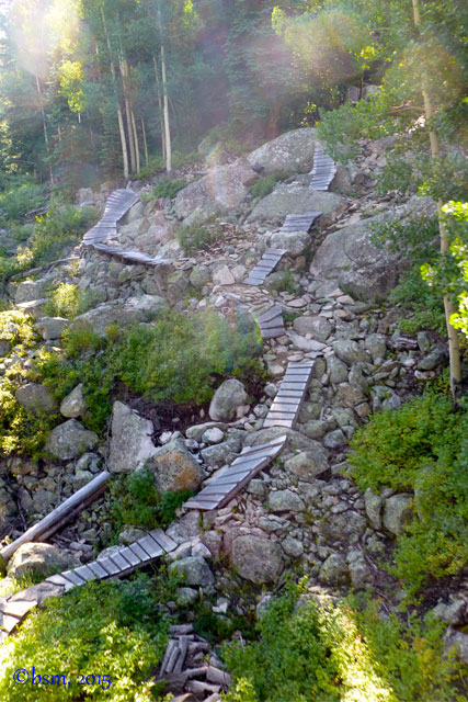 psycho rocks, an expert downhill bike trail crafted from ramps and bridges and crossing over rocks in the crested butte evolution bike park