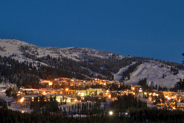 big white village at night.