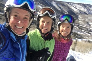 three friends skiing in colorado