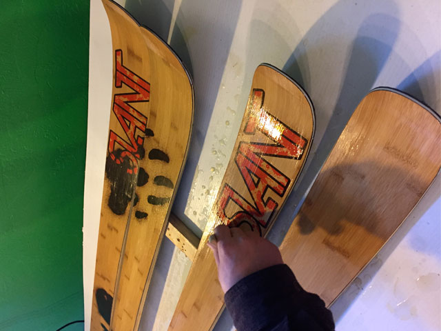 slant skis being stenciled with logo