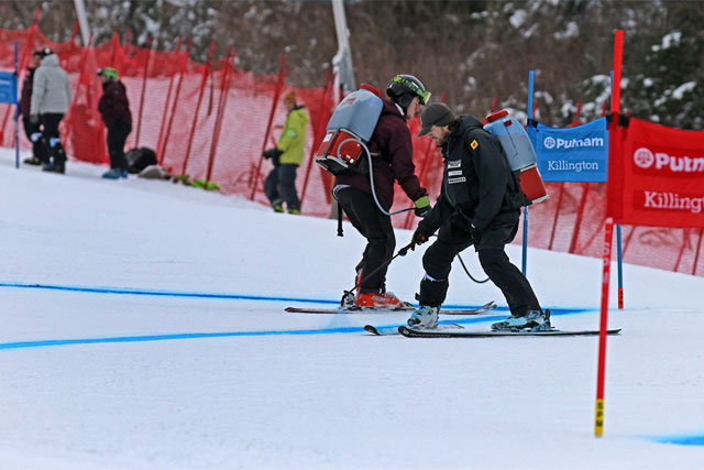 Race crew painting blue lines on the snow for the Killington World cup races.