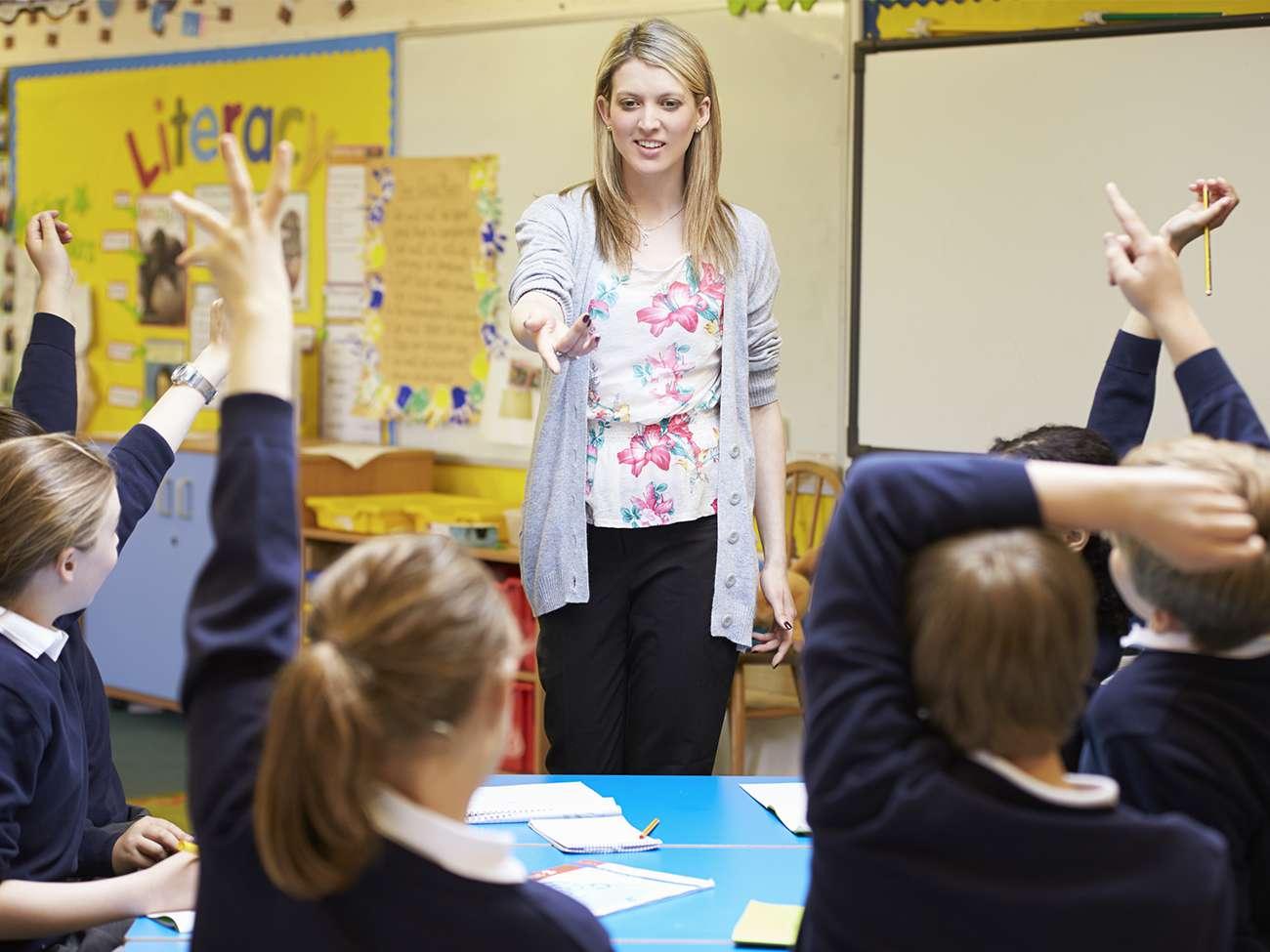 Adult (Teacher) asking school children questions