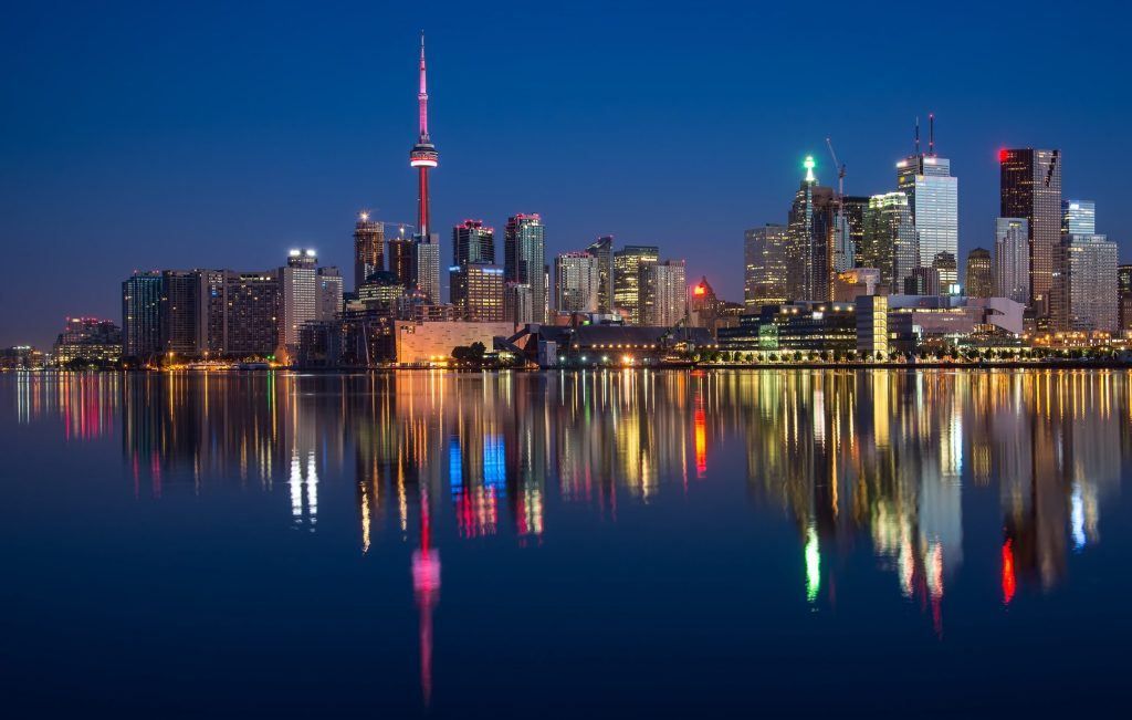 Nighttime skyline of the City of Toronto with its reflection in the water