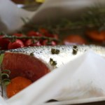Baked salmon tail with capers and grape tomatoes