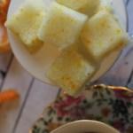 maple orange sugar cubes on plate by tea