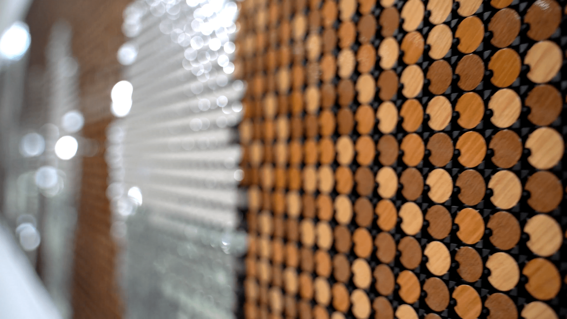 Close-up of wood and silver Flip-Discs art installation called