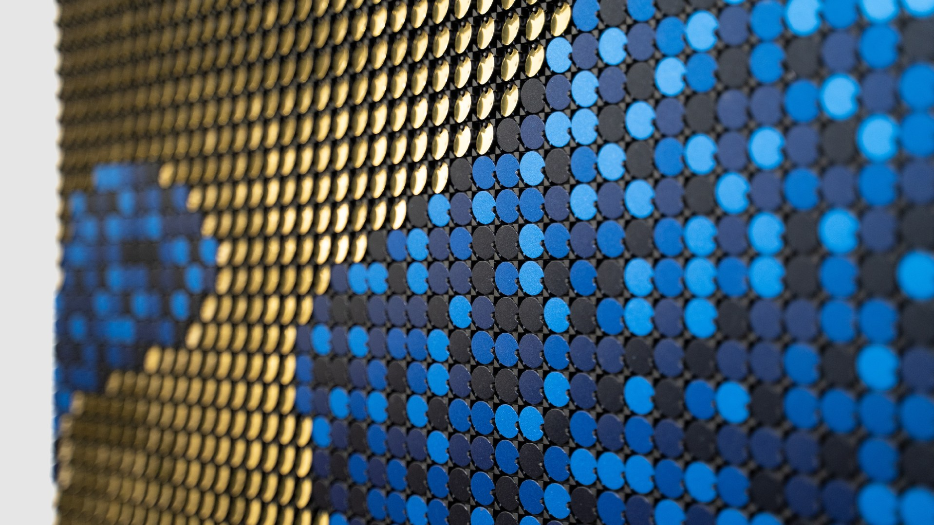 Close up of blue and gold Flip-Discs artwork called