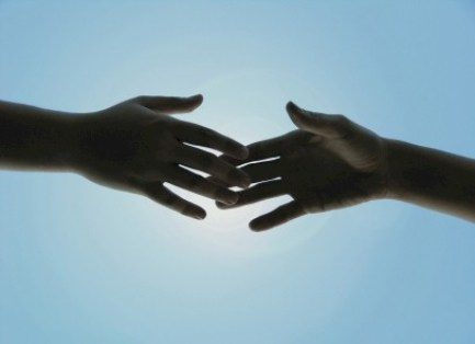 love story - hands reaching out in love