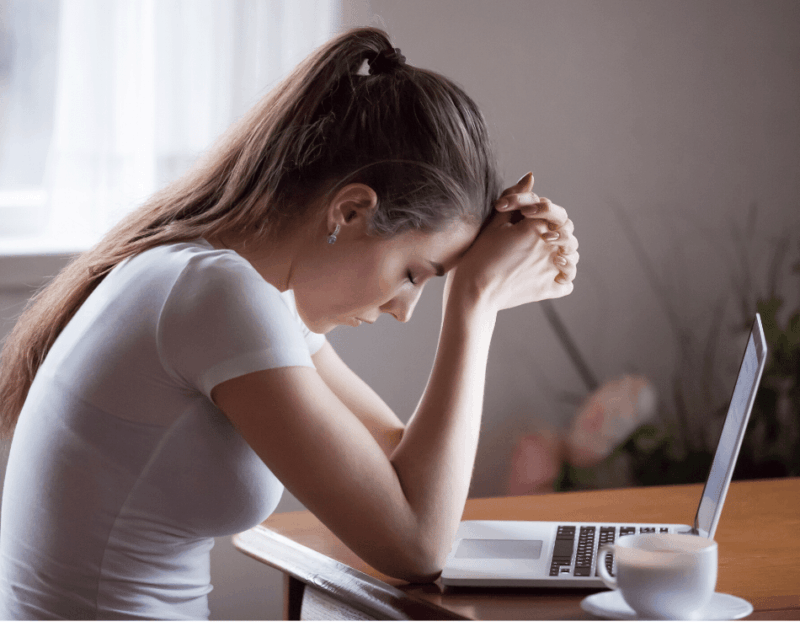Why It's Important to Be Self Aware-Stressed Woman in front of laptop