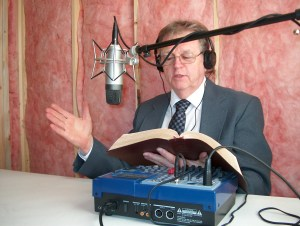 Pastor Don Randall making recordings for the radio