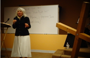 Pastor Alana preaching the Word of God with an emphasis on true holiness