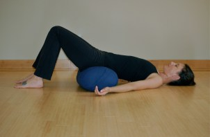 Supported Bridge Yoga Pose For Breast Cancer