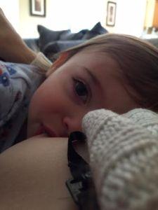 Beautiful view of my baby girl nursing.