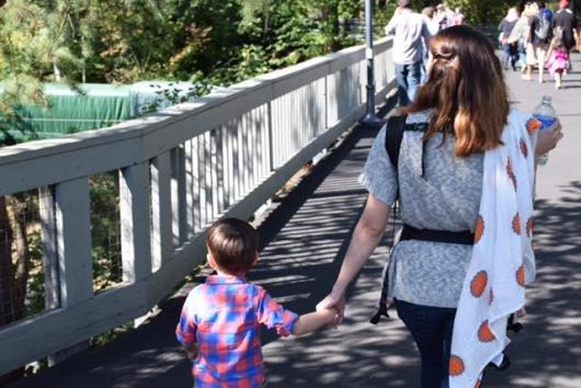 Walking at the Oregon Zoo with my babes while breastfeeding my daughter.