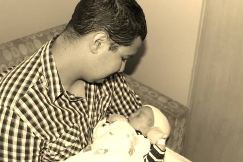 My husband and son after birth