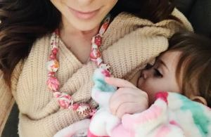 Nursing and loving our The Vintage Honey Shop breastfeeding necklace.