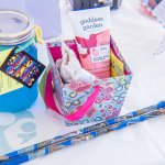 """Central Indiana's 2017 Big Latch On, """"Play with me"""" Raffle Basket Featuring Bubbles from Joyful Bubbles, Gift Certificate from The Eco Baby Co., Kleynimals Stainless Steel teething ring, and Goddess Garden Sunscreen"""