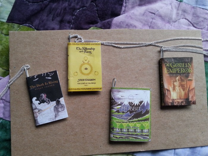 Four book necklaces: Lord of the Rings, The Hobbit, The Dark is Rising and The Goblin Emperor