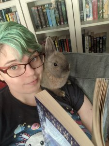Photo of Biscuit and Nikki reading