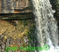 My son under a Waterfall - Family Adventures