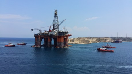 Drilling platform being pulled into the harbour