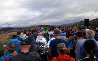 Photo shows thousands of runners on Old Military Road ready to begin the marathon