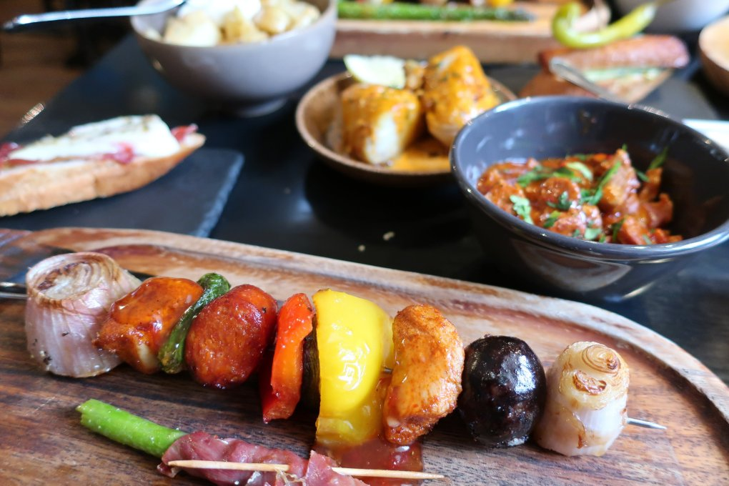 Photos shows an array of colourful food from Sol y sombra Tapas Bar