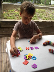 Vince sounding out foam letter words