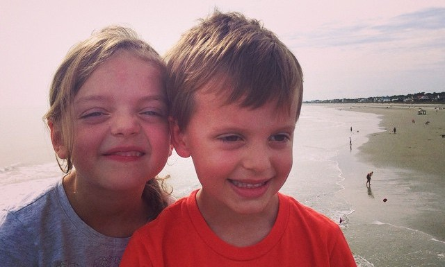 A moment of sibling love at Folly Beach…. Just before some biting