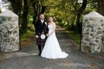 Bridal couple at gate
