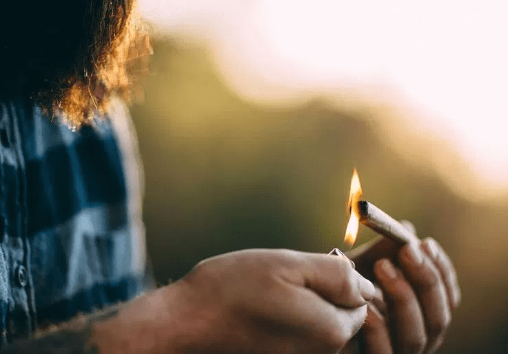 cannabis user lighting a joint