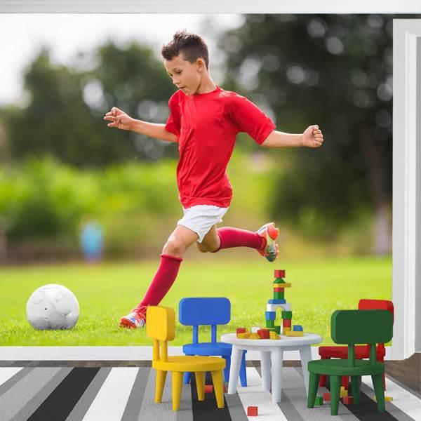 Fototapet til Barnerom - Motiv Barn som spiller fotball