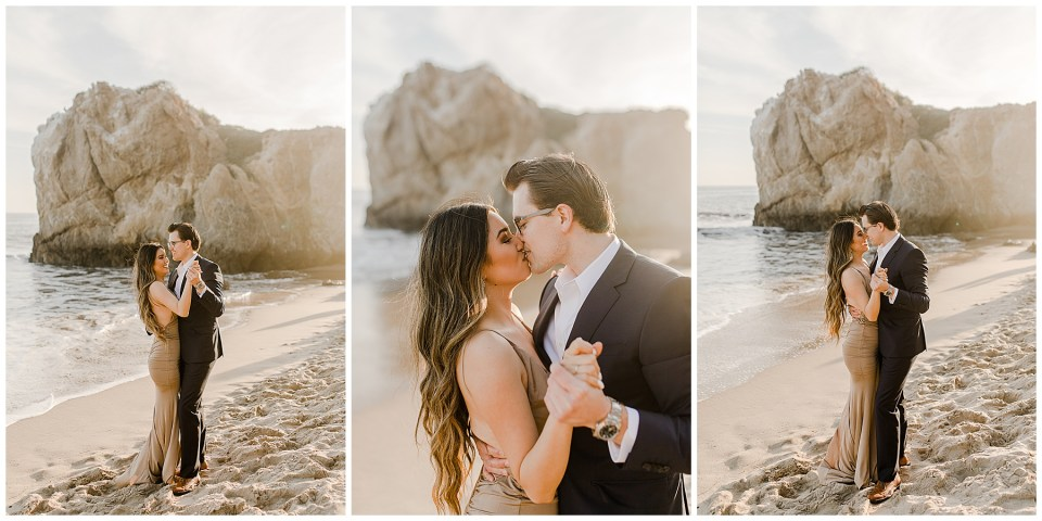 couple on the beach at el matador beach taking engagement photos