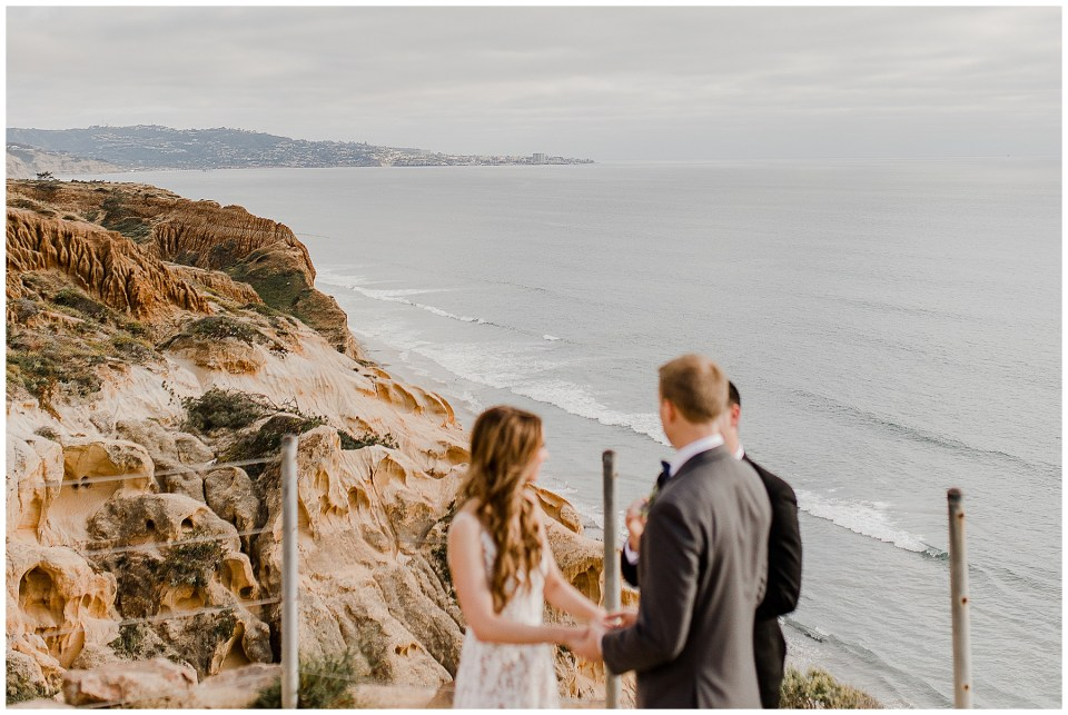 couple says their vows at the oceanfront cliffs of torrey pines