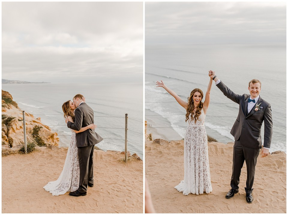 bride and groom share their first kiss at torrey pines