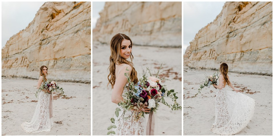 bride takes pictures on the beach at torrey pines
