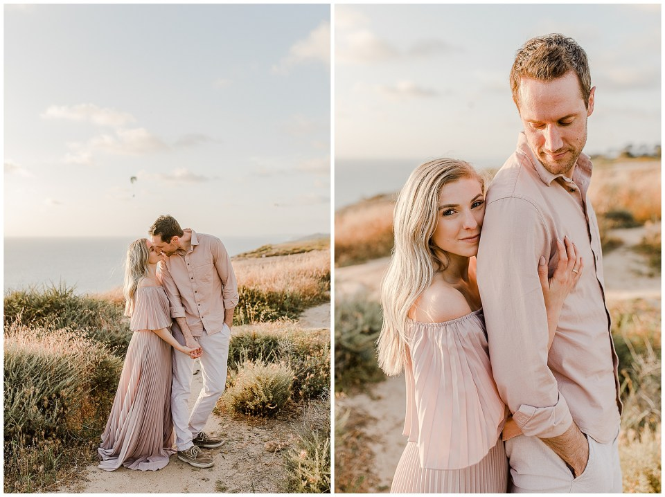 man and woman kissing during their torrey pines gliderport engagement photos