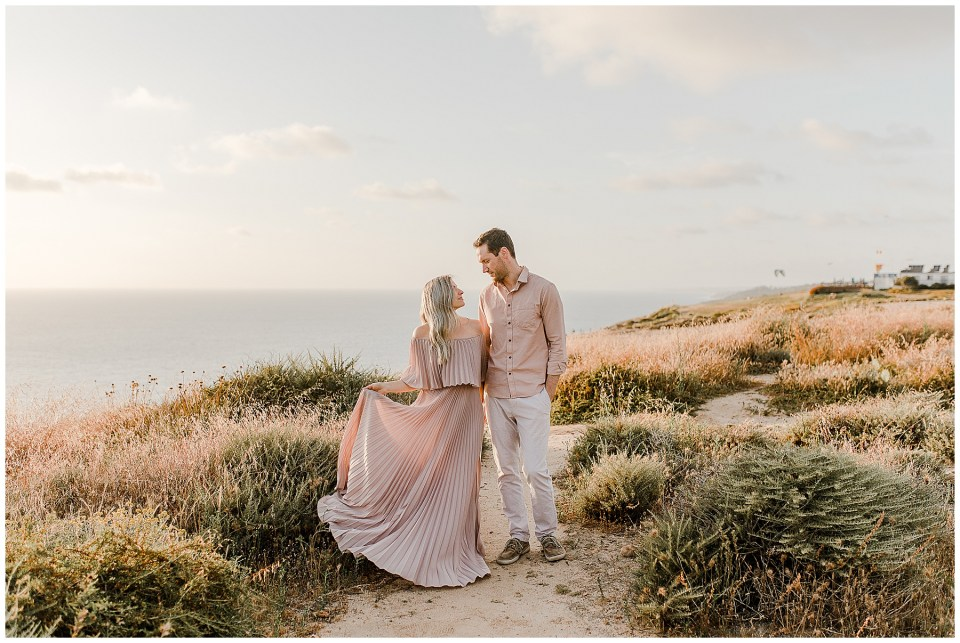 man and woman looking into each others eyes during engagement photos in torrey pines, California