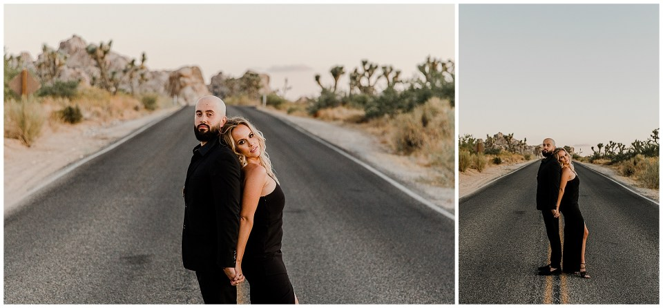 man and woman standing in the road during their engagement pictures in joshua tree national park